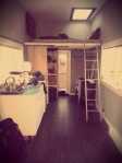 A blurry shot of the interior, with floors and cabinets and trim.