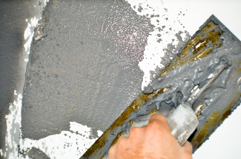 Troweling the plaster.