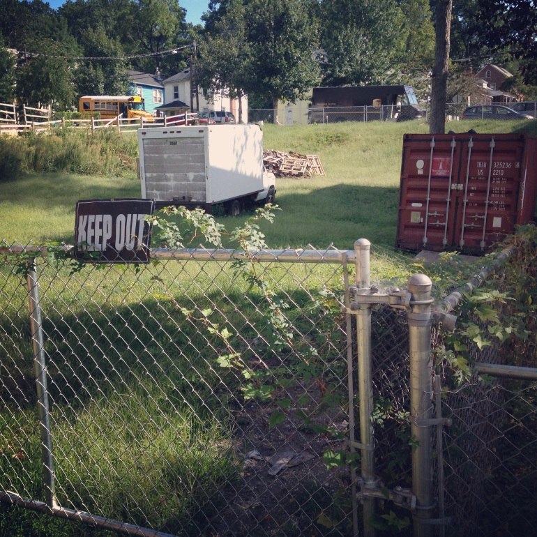Private lot with a shipping container and truck